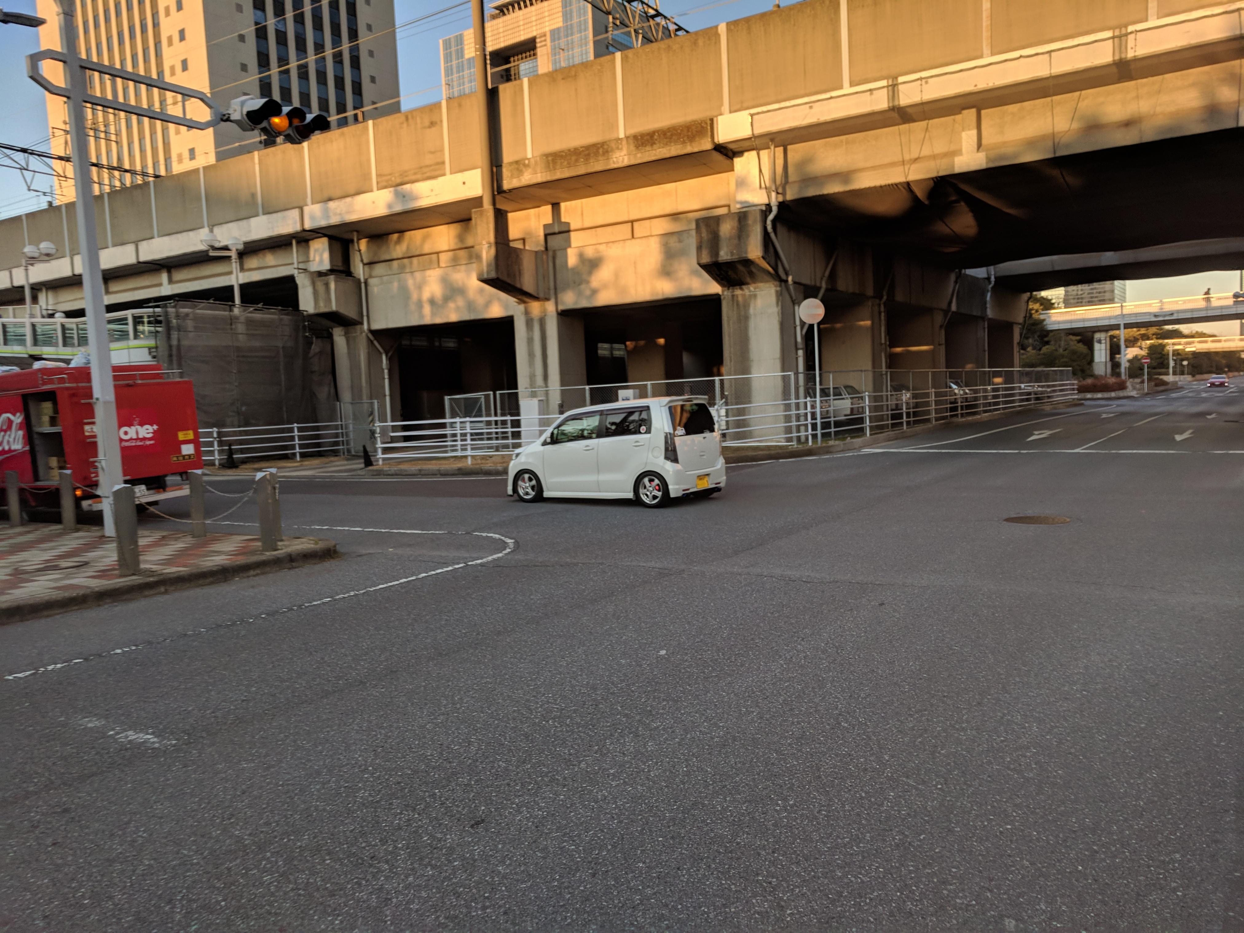 Slammed kei car near the Auto Salon.